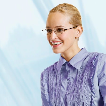 Portrait of young happy smiling blond business woman, at office Stock Photo - 15959785