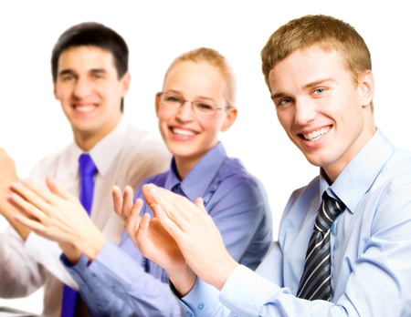 Three happy clapping businesspeople at presentation, meeting, seminar or conference Stock Photo - 15959756