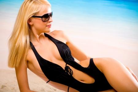 blonde bikini: Portait of happy smiling cheerful young beautiful blond woman on the beach Stock Photo