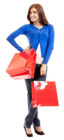 Cheerful smiling woman with red shopping bags, isolated over white background Stock Photo - 16085154
