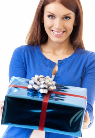 Cheerful woman showing gift, isolated over white background photo