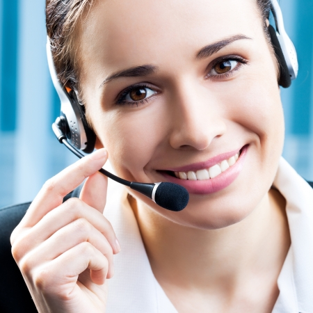 call center agent: Portrait of happy smiling cheerful support phone operator in headset at office