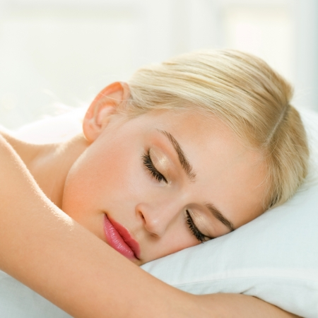 up wake: Young beautiful blond woman sleeping on bed Stock Photo
