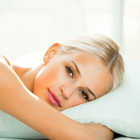 Young beautiful happy smiling blond woman waking up on bed  Stock Photo - 16105145