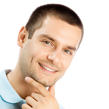 Cheerful thinking young man, isolated over white background photo