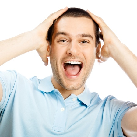 expressive face: Portrait of young man with shocked facial expression, isolated over white background Stock Photo
