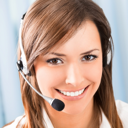 customer services: Portrait of happy smiling cheerful support phone operator in headset at office
