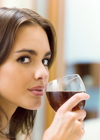 only women: Portrait of young happy smiling cheerful beautiful woman with glass of red wine