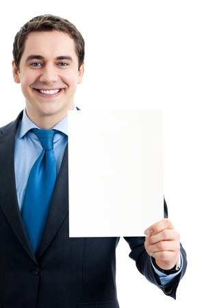 Young happy smiling businessman showing signboard with copyspase for text or slogan, isolated over white background photo
