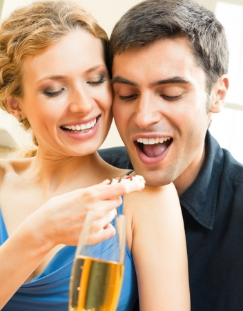 amorous woman: Cheerful couple eating cookies