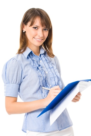 Happy smiling cheerful young business woman writing on documents, isolated on white background photo