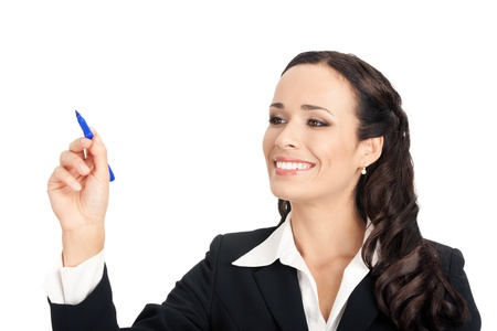 writing on glass: Happy smiling cheerful beautiful young business woman writing or drawing something on screen or transparent glass, by blue marker, isolated over white background Stock Photo