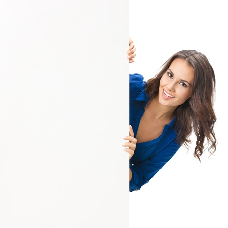 a signboard: Happy smiling beautiful young woman showing blank signboard or copyspace, isolated over white background