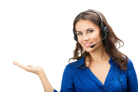 assist: Portrait of happy smiling cheerful beautiful young support phone operator showing; isolated over white background Stock Photo
