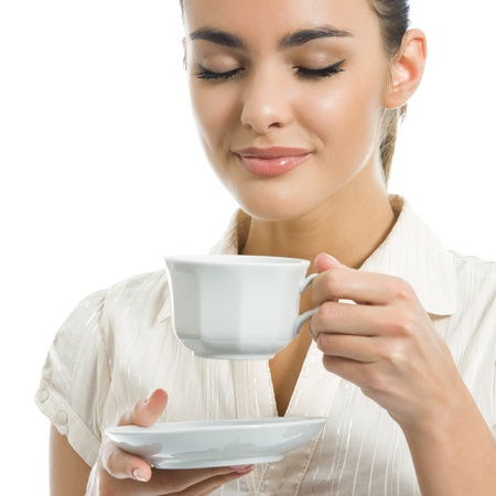 woman drinking tea: Young happy woman with cup of coffee, isolated over white background