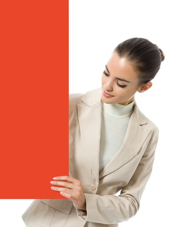 blank area: Happy young business woman showing blank red signboard, isolated over white background Stock Photo