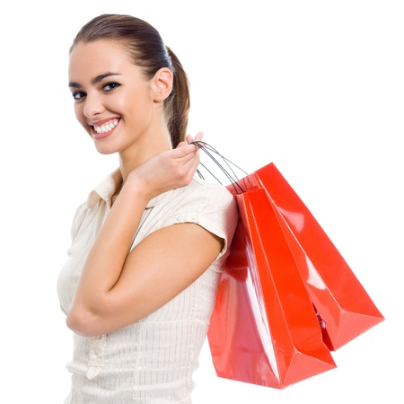 Portrait of young happy smiling woman with shopping bags, isolated over white background Stock Photo - 16824088
