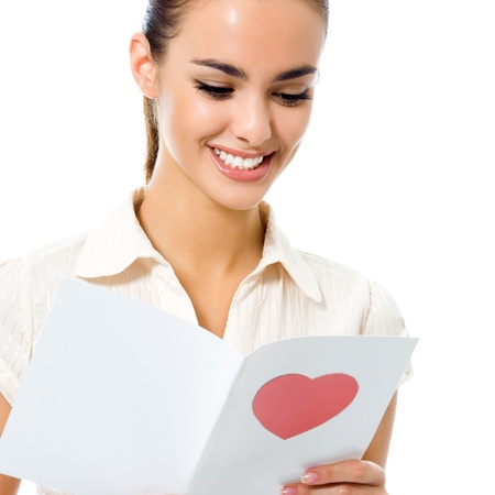 Young happy woman reading valentine card, isolated over white background photo