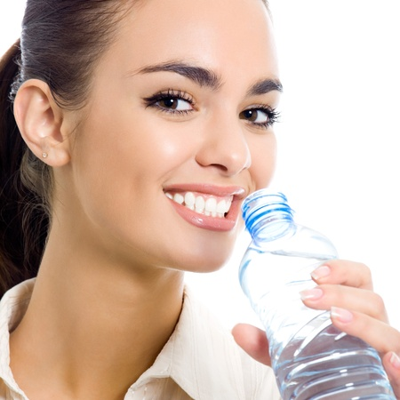 Young business woman drinking water, isolated over white background photo