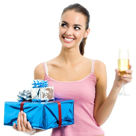 Young smiling woman with gift and champagne, isolated over white background photo