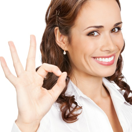 Happy smiling business woman with okay gesture, isolated over white background photo