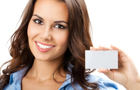 Happy smiling business woman showing blank business card, isolated over white backround photo