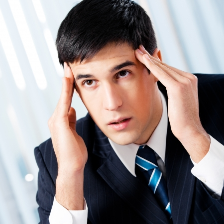 Thinking, tired or ill with headache businessman at office Stock Photo - 17154678