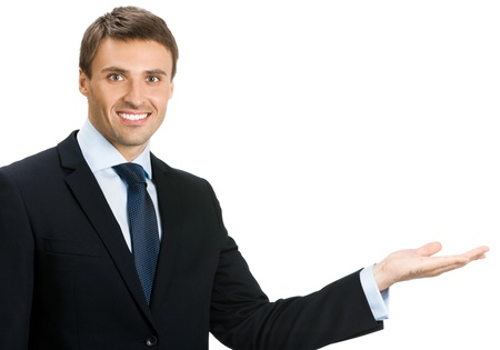 blank area: Happy smiling young business man showing blank area for sign or copyspase, isolated over white background