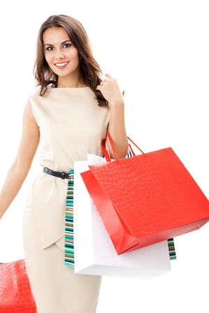Portrait of young happy smiling woman with shopping bags, isolated over white background Stock Photo - 17167156