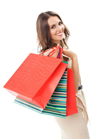 Portrait of young happy smiling woman with shopping bags, isolated over white background Stock Photo - 17167157