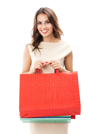 1 woman only: Portrait of young happy smiling woman with shopping bags, isolated over white background