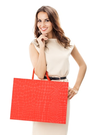 Portrait of young happy smiling woman with shopping bags, isolated over white background Stock Photo - 17167122
