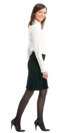 Full body portrait of walking business woman, isolated over white background photo