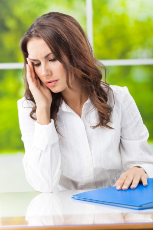 Thinking, tired or ill with headache business woman at office Stock Photo - 17286421