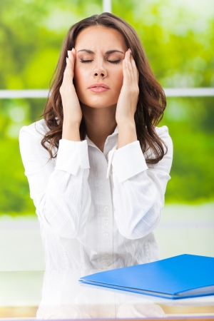 Thinking, tired or ill with headache business woman at office Stock Photo - 17272315