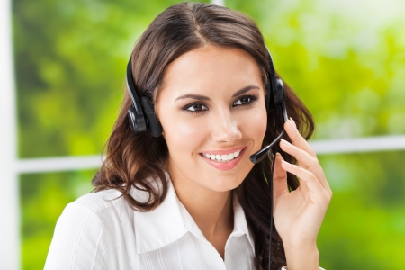 operators: Portrait of happy smiling cheerful beautiful young support phone operator in headset, at office
