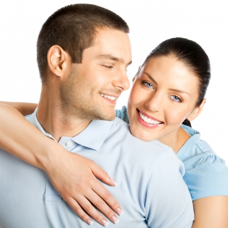 happy couple white background: Portrait of young happy smiling attractive couple, isolated over white background
