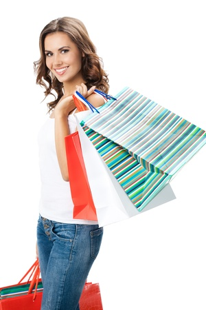shopping bag: Portrait of young happy smiling woman with shopping bags, isolated over white background