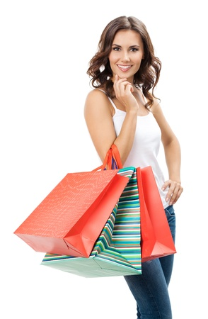 Portrait of young happy smiling woman with shopping bags, isolated over white background Stock Photo - 17447436