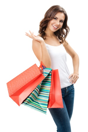 only 1 woman: Portrait of young happy smiling woman with shopping bags, isolated over white background