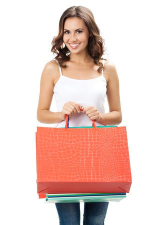 Portrait of young happy smiling woman with shopping bags, isolated over white background Stock Photo - 17447447