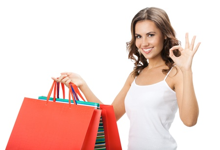 Portrait of young happy smiling woman with shopping bags, isolated over white background Stock Photo - 17447439