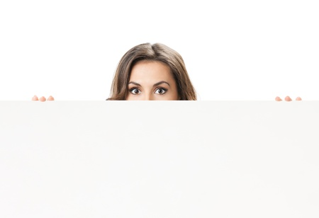 Young woman with blank signboard or copyspace for slogan or text, isolated over white background photo