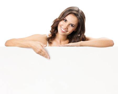 holding a sign: Happy smiling beautiful young woman showing blank signboard or copyspace for slogan or text, isolated over white background
