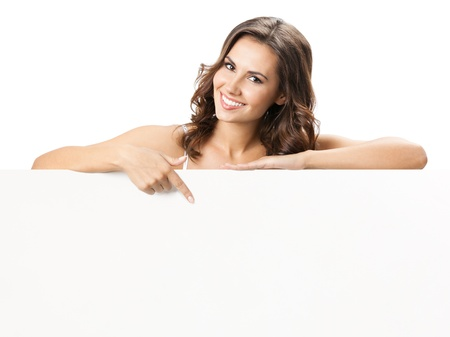 woman pointing: Happy smiling beautiful young woman showing blank signboard or copyspace for slogan or text, isolated over white background