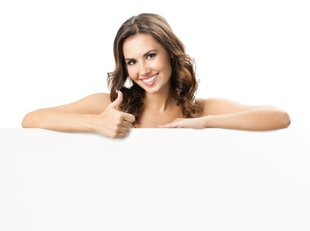 slogan: Happy smiling beautiful young woman showing blank signboard or copyspace for slogan or text, isolated over white background