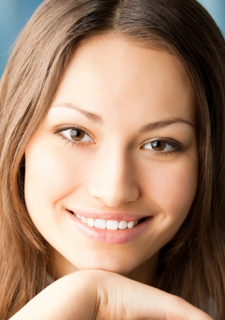 Close up portrait of beautiful smiling young woman Stock Photo - 17455167