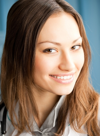 Portrait of cheerful female doctor at office Stock Photo - 17455153