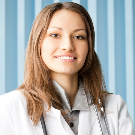 Portrait of cheerful female doctor at office Stock Photo - 17455159