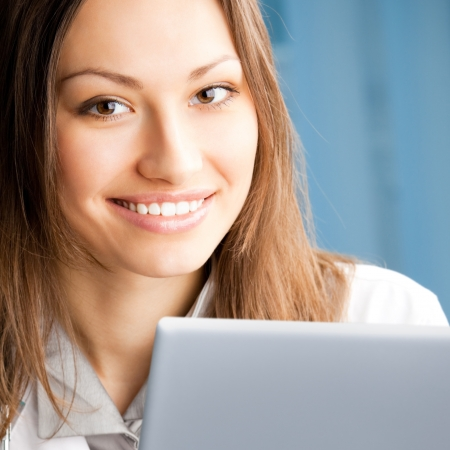Portrait of cheerful female doctor working with laptop at office Stock Photo - 17455855